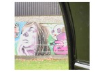 Image of street art/woman's face in spray paint. Chaddesden Park.