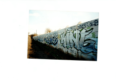 Image of wall covered in graffiti in Derby.