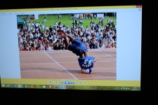 Deda breakdancing photo on flatscreen at club